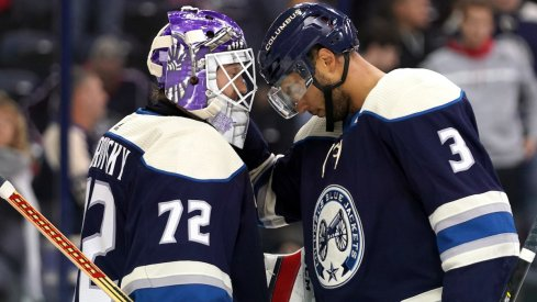 Columbus Blue Jackets defenseman Seth Jones celebrates a 4-2 win over the Minnesota Wild with goaltender Sergei Bobrovsky.