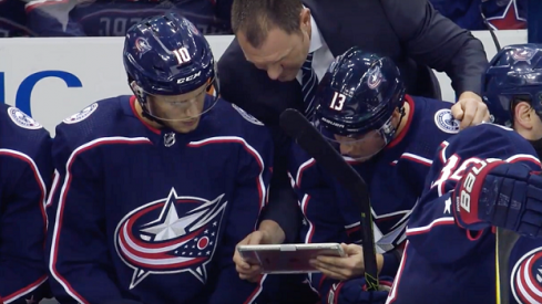 Brad Larsen works with the Columbus Blue Jackets forwards during a break in the action
