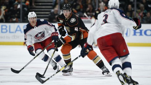 Seth Jones and Riley Nash defend against Ducks defencemen Cam Fowler