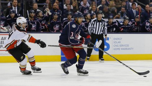 Seth Jones is stick-checked by Adam Henrique as the Blue Jackets dropped a 2-1 game in overtime to the Anaheim Ducks