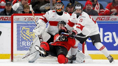 Blue Jackets prospect Tim Berni lays out Taylor Raddysh in front of the net at the 2018 World Junior Championship
