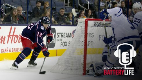 Cam Atkinson tries to find a play to make behind the net against the Toronto Maple Leafs