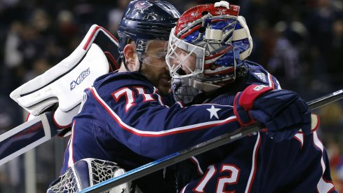 Nick Foligno and Sergei Bobrovsky hug it out following a win over the New York Rangers.