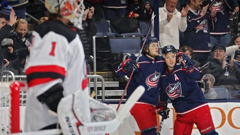 Artemi Panarin and Cam Atkinson celebrate scoring against the New Jersey Devils
