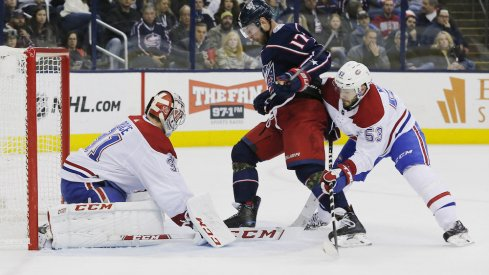 Columbus Blue Jackets center Brandon Dubinsky drives the Montreal Canadiens net guarded by Carey Price during a game at Nationwide Arena.