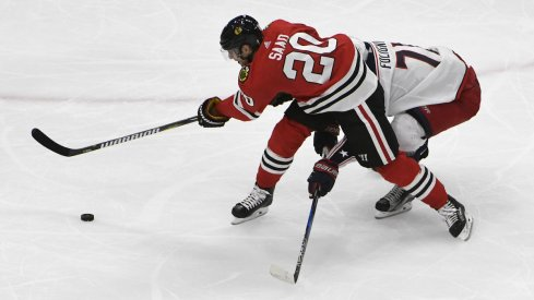 Columbus Blue Jackets captain Nick Foligno defends against Chicago Blackhawks forward Brandon Saad at United Center.