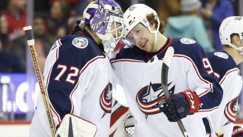 Artemi Panarin and Sergei Bobrovsky celebrate a win.
