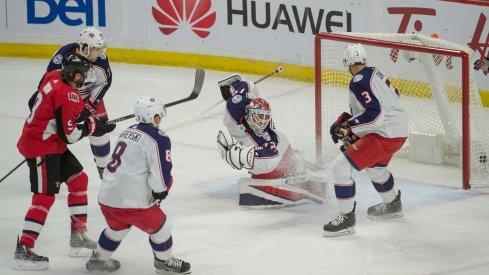 Sergei Bobrovsky tries to save the puck against the Ottawa Senators.