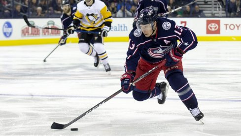 Cam Atkinson skates down the ice with the puck against the Pittsburgh Penguins at Nationwide Arena