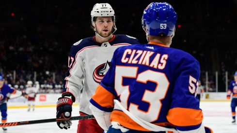 Josh Anderson stares down Casey Cizikas in between play during Blue Jackets-Islanders.