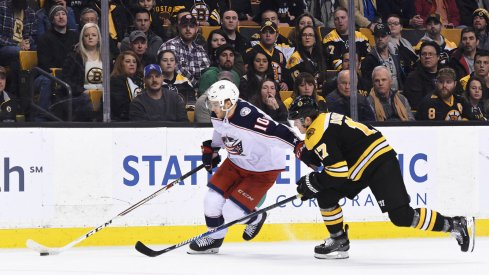 Alex Wennberg carries the puck against the Boston Bruins