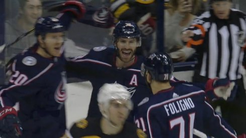 Columbus Blue Jackets center Boone Jenner celebrates the 100th goal of his NHL career with Nick Foligno and Riley Nash.