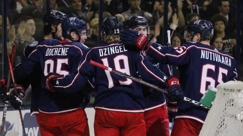 Matt Duchene, Ryan Dzingel, and Josh Anderson celebrate a goal against the Blue Jackets against the Boston Bruins