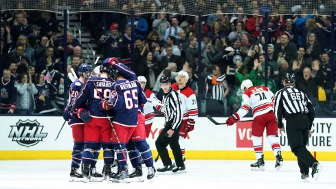 The Columbus Blue Jackets celebrate a first period goal from defenseman David Savard against the Carolina Hurricanes at Nationwide Arena.
