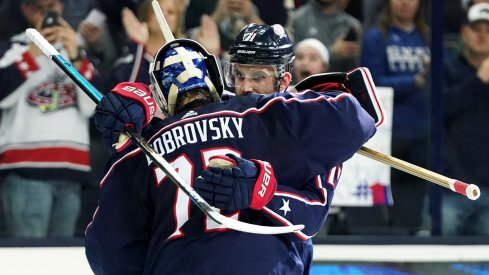 Nick Foligno and Sergei Bobrovsky hug after a win.