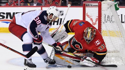 David Rittich makes a save against Columbus Blue Jackets forward Boone Jenner