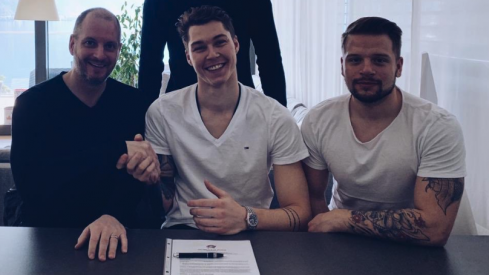 Elvis Merzlikins signs his first NHL contract with the Columbus Blue Jackets
