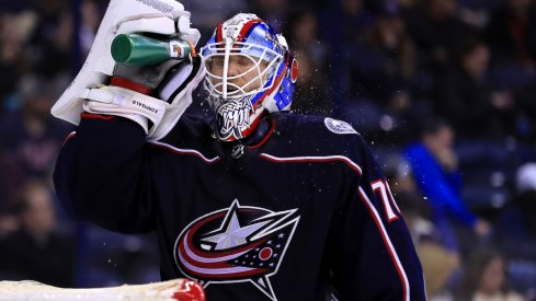 Columbus Blue Jackets goaltender Joonas Korpisalo takes a break during a game at Nationwide Arena.