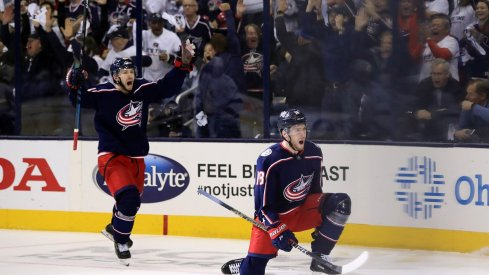 Oliver Bjorkstrand and Pierre-Luc Dubois celebrate after scoring against the Tampa Bay Lightning