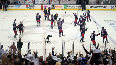 The Columbus Blue Jackets celebrate their first round win over the Tampa Bay Lightning at Nationwide Arena