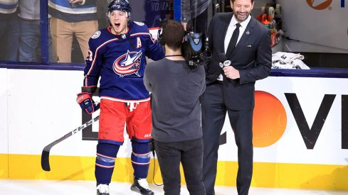 Cam Atkinson celebrates the Blue Jackets first ever playoff series win.