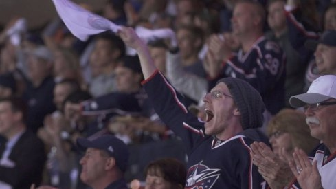 A fan celebrates during the Blue Jackets Game 4 win over the Tampa Bay Lightning