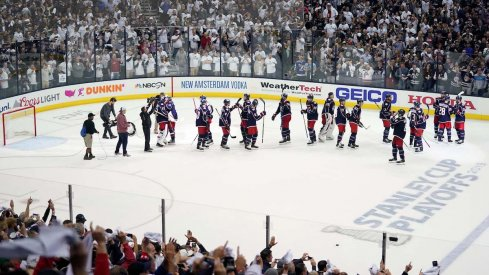 The Columbus Blue Jackets salute their crowd at Nationwide Arena after a Game 4 win over the Tampa Bay Lightning.