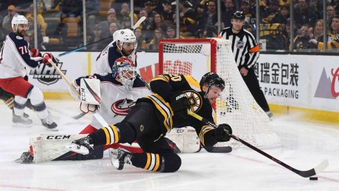 Apr 27, 2019; Boston, MA, USA; Boston Bruins center Joakim Nordstrom (20) tries to gain control of the puck in front of Columbus Blue Jackets goaltender Sergei Bobrovsky (72) during the second period in game two of the second round of the 2019 Stanley Cup Playoffs at TD Garden.