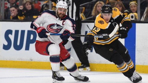 Nick Foligno and Charlie Coyle battle for the puck in Game 2 between the Columbus Blue Jackets and Boston Bruins.