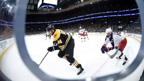 Boston Bruins left wing Jake DeBrusk (74) and Columbus Blue Jackets center Brandon Dubinsky (17) chase after the puck during the second period in game two of the second round of the 2019 Stanley Cup Playoffs at TD Garden