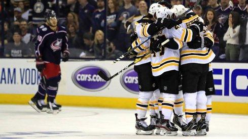 Patrice Bergeron celebrates with his Bruins teammates after scoring to put Boston up 2-0 on Columbus in Game 4.