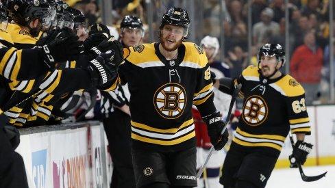 David Pastrnak celebrates a goal with his Boston Bruins teammates
