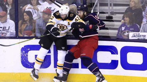 Columbus Blue Jackets defenseman David Savard collides with Boston Bruins forward David Backes during Game 6 at Nationwide Arena.