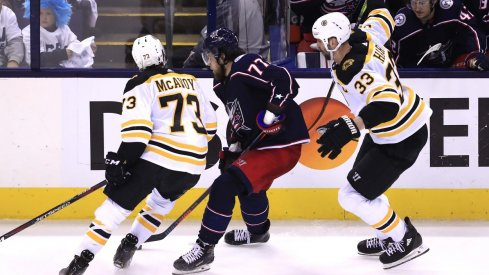 Boston Bruins defenseman Charlie McAvoy (73) is called for an illegal check to the head against Columbus Blue Jackets right wing Josh Anderson (77) in the second period during game six of the second round of the 2019 Stanley Cup Playoffs at Nationwide Arena.