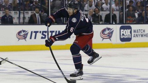 Zach Werenski wrists a shot on goal against the Boston Bruins