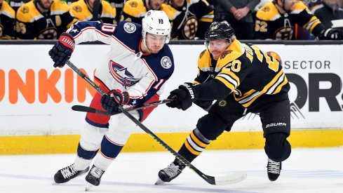 Alexander Wennberg fights for a loose puck against the Boston Bruins