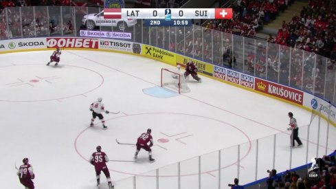 Elvis Merzlikins drops Kevin Fiala to the ice at the IIHF World Championship