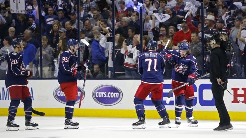 Matt Duchene, Nick Foligno and Artemi Panarin celebrate after defeating the Boston Bruins in game three of the second round of the 2019 Stanley Cup Playoffs