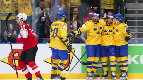 Alexander Wennberg celebrates with the rest of his Sweden teammates as they score a goal against Switzerland