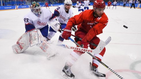 Olympic Athlete from Russia forward Sergei Andronov (11) plays the puck ahead of Norway goaltender Henrik Haukeland (33) and defenseman Mattias Norstebo (10) in the second period of the men's hockey quarterfinals during the Pyeongchang 2018 Olympic Winter Games at Gangneung Hockey Centre.