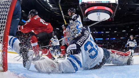 Columbus Blue Jackets prospect Veini Vehvilainen scrambles for position during a game for Team Finland.