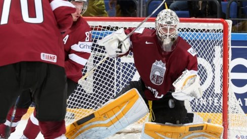 Elvis Merzlikins makes a save for Latvia at the World Championships in Slovakia