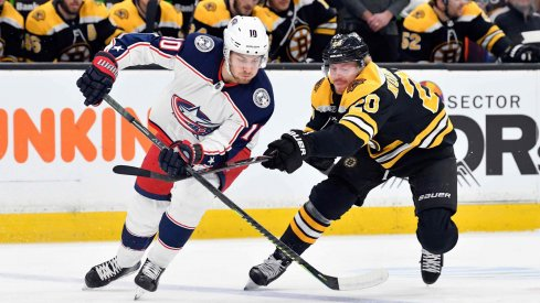 Mar 16, 2019; Boston, MA, USA; Columbus Blue Jackets center Alexander Wennberg (10) and Boston Bruins center Joakim Nordstrom (20) battle for control of the puck during the first period of a game at the TD Garden.