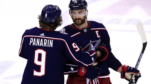 Columbus Blue Jackets left wing Artemi Panarin (9) hugs left wing Nick Foligno (71) after being defeated by the Boston Bruins in game six of the second round of the 2019 Stanley Cup Playoffs at Nationwide Arena.