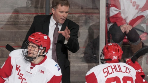 Mike Eaves, new head coach of the Cleveland Monsters, guides the University of Wisconsin men's hockey team.
