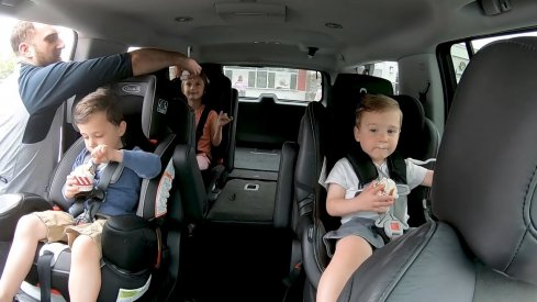 Nick Foligno begins to seat belt his children in anticipation of a car ride.