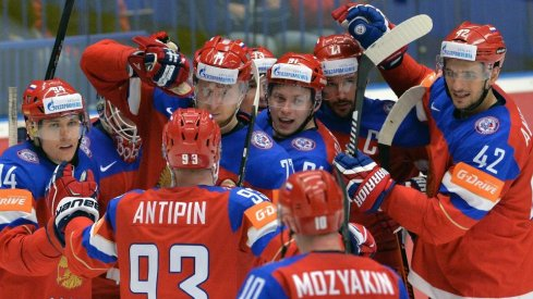 Russian forwards celebrate after scoring a goal.