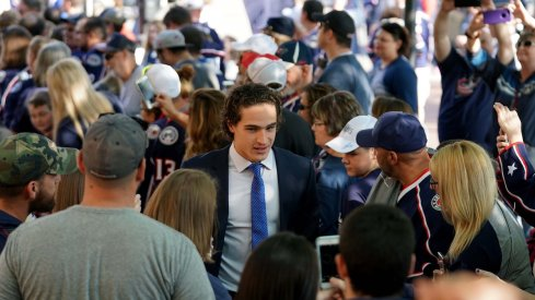 Columbus Blue Jackets left wing Sonny Milano (22) high fives fans while walking the Blue Carpet entrance prior to the game against the Carolina Hurricanes at Nationwide Arena.