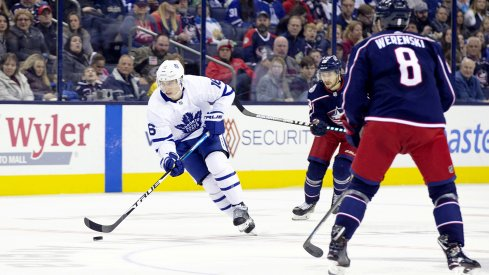 Toronto Maple Leafs right wing Mitchell Marner (16) skates with the puck up ice during the second period against the Columbus Blue Jackets at Nationwide Arena.
