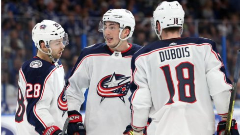 Columbus Blue Jackets forward Oliver Bjorkstrand, defenseman Zach Werenski and center Pierre-Luc Dubois discuss with one another at Amalie Arena during their matchup with the Tampa Bay Lightning in the 2019 Stanley Cup Playoffs.